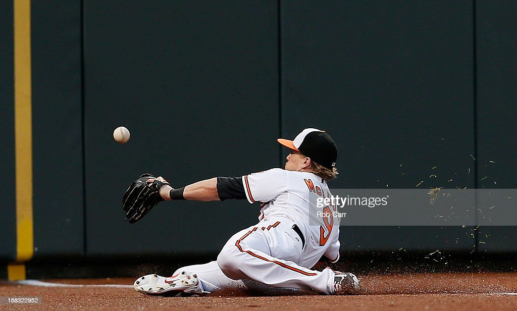 Left fielder Nate McLouth #9 of the Baltimore Orioles misses catching a ball in foul territory hit by Elliot Johnson #23 of the Kansas City Royals (not pictured) during the second inning at Oriole Park at Camden Yards on May 8, 2013 in Baltimore, Maryland.