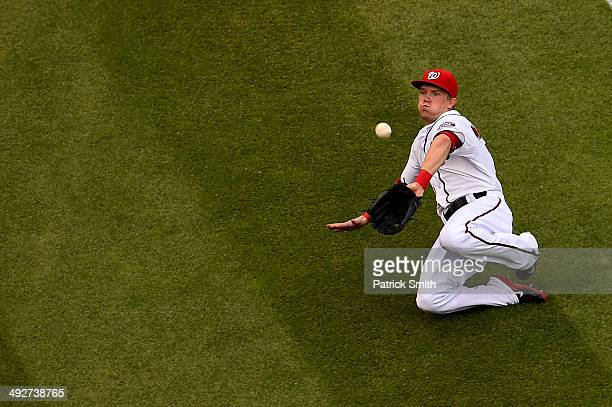 Left fielder Nate McLouth of the Washington Nationals makes a catch on Billy Hamilton of the Cincinnati Reds in the fifth inning at Nationals Park on...