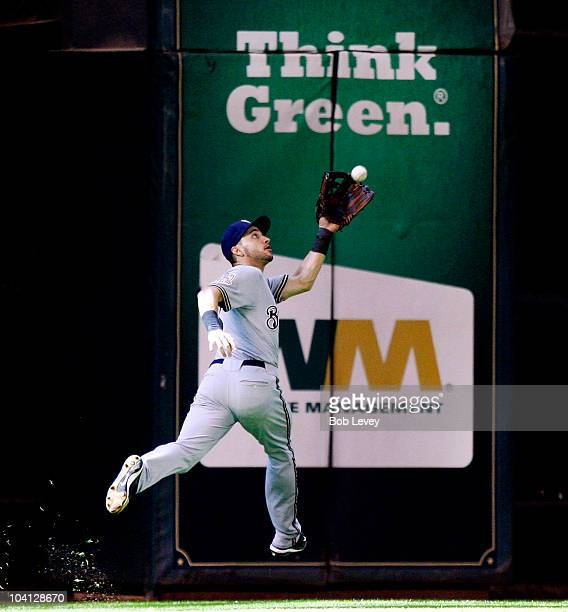 Left fielder Ryan Braun of the Milwaukee Brewers makes a running catch on a ball hit by Angel Sanchez of the Houston Astros in the ninth inning at...