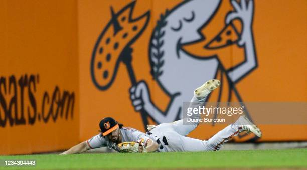 Left fielder Ryan McKenna of the Baltimore Orioles makes a diving catch of a fly ball hit by Willi Castro of the Detroit Tigers during the seventh...