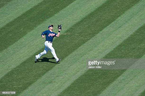 Left fielder Ryan Raburn of the Cleveland Indians catches a fly ball hit by Yonder Alonso of the San Diego Padres during the first inning during the...