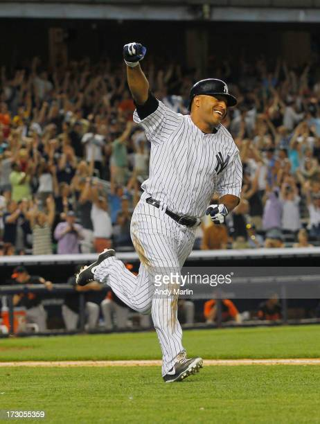 Left fielder Vernon Wells of the New York Yankees reacts after hitting a game-winning walkoff single in the bottom of the ninth inning against the...