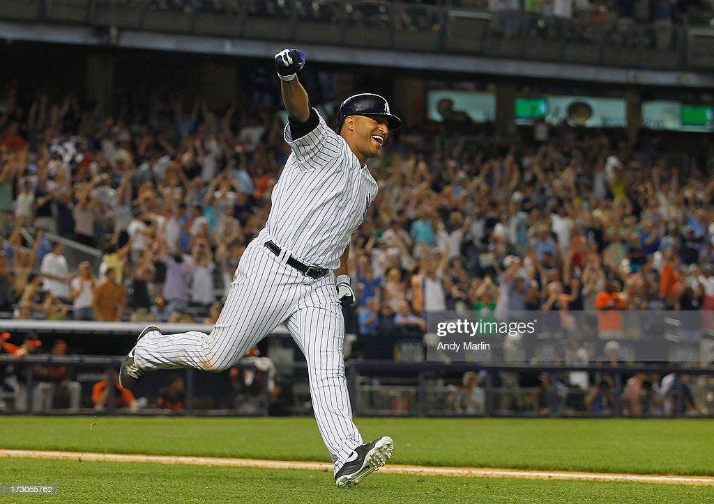 Left fielder Vernon Wells #12 of the New York Yankees reacts after hitting a game-winning walkoff single in the bottom of the ninth inning against the Baltimore Orioles at Yankee Stadium on July 5, 2013 in the Bronx borough of New York City. The Yankees defeated the Orioles 3-2.