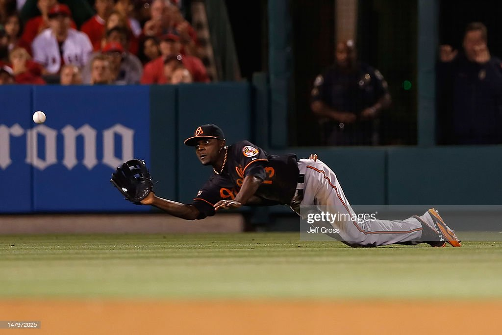 Left fielder Xavier Avery #13 of the Baltimore Orioles makes a diving catch on a ball hit by Maicer Izturis of the Los Angeles Angels of Anaheim in the eighth inning at Angel Stadium of Anaheim on July 6, 2012 in Anaheim, California. The Orioles defeated the Angels 3-2.