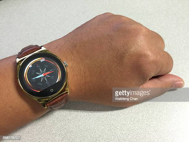 Left hand checking bearing and direction using smart watch