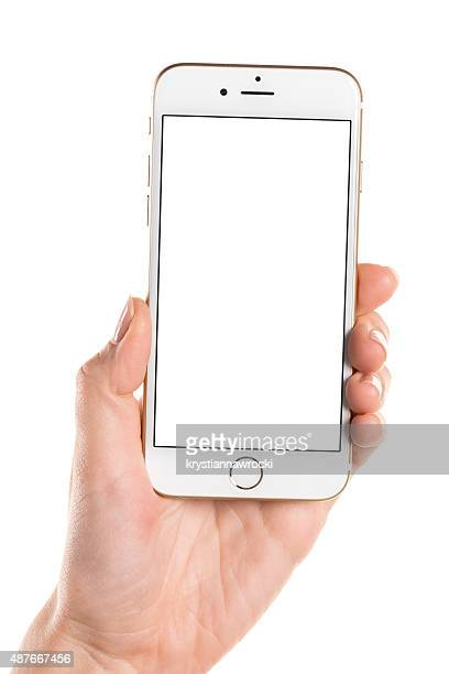 Left hand holding gold iPhone 6 with white screen