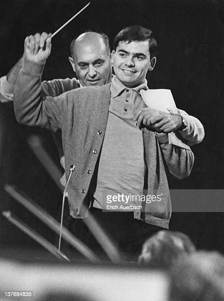 Hungarian-British orchestral and operatic conductor Georg Solti instructing composer Malcolm Binney on a BBC television conducting workshop...