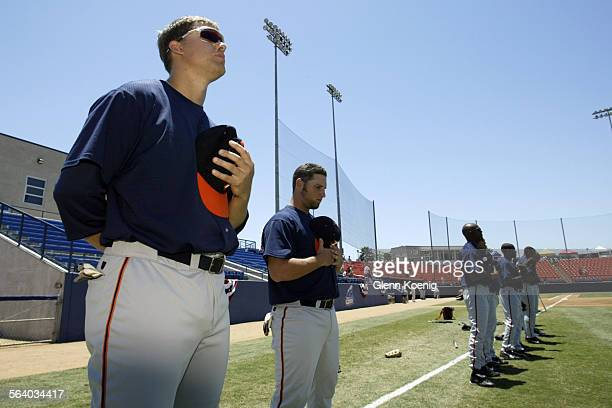 Left Rick Elder and other players of the Fullerton Flyers listen to the National Athem before the start of a game between the Fullerton Flyers and...