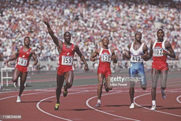Left - right Desai Williams look across at Ben Johnson of Canada who holds his arm aloft in victory over Calvin Smith of the USA, Linford Christie of...