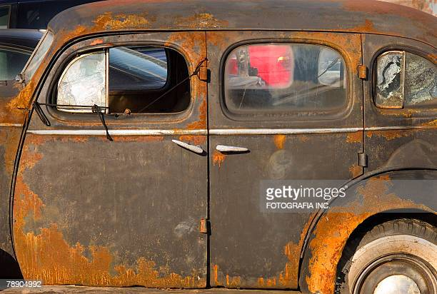 left side of an old rusted vintage american car, four door sedan. - rusty stock pictures, royalty-free photos & images