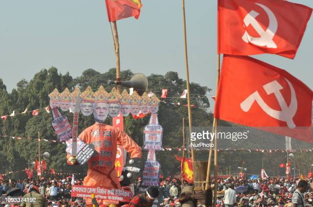 Left Supporters hold a big Effigy of Indian Prime Minister Narendra Modi at the Left Front political parties at the Public meeting in general...
