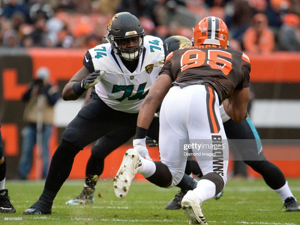 Left tackle Cam Robinson #74 of the Jacksonville Jaguars engages defensive end Myles Garrett #95 of the Cleveland Browns in the first quarter of a game on November 19, 2017 at FirstEnergy Stadium in Cleveland, Ohio. Jacksonville won 19-7.