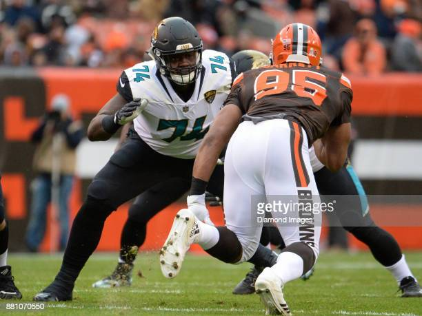 Left tackle Cam Robinson of the Jacksonville Jaguars engages defensive end Myles Garrett of the Cleveland Browns in the first quarter of a game on...