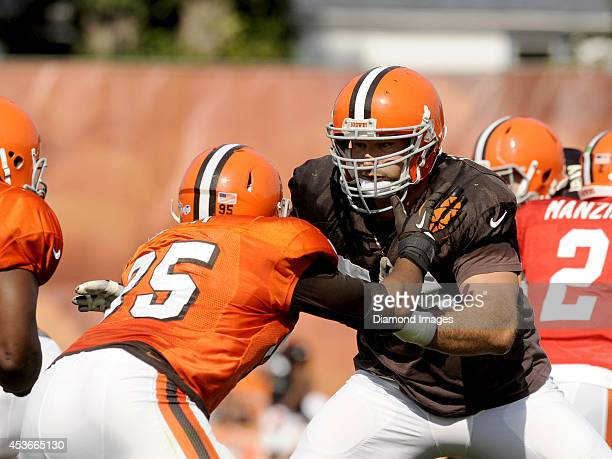 Left tackle Joe Thomas and defensive end Armonty Bryant of the Cleveland Browns engage at the line of scrimmage during a training camp practice on...
