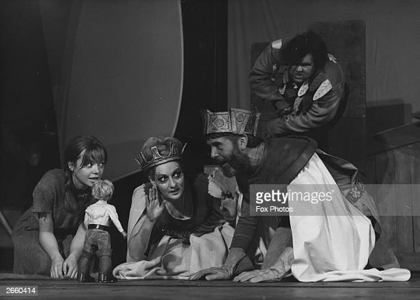 Angharad Rees Tilly Tremayne and Arthur Skinner inspecting a tiny model Gulliver in a scene from the pantomime 'Gulliver's Travels' at London's...