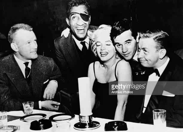 actor Jacques Sernas Sammy Davis Jr Marilyn Monroe photographer Milton H Greene and jazz musician Mel Torme at the Crescendo Club Los Angeles...