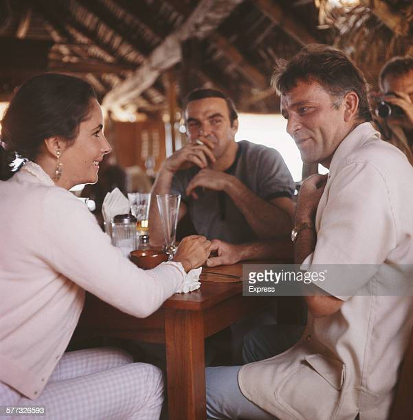 actors Elizabeth Taylor Stanley Baker and Richard Burton in a bar Puerto Vallarta Mexico 12th January 1964 Burton is in Mexico for location filming...
