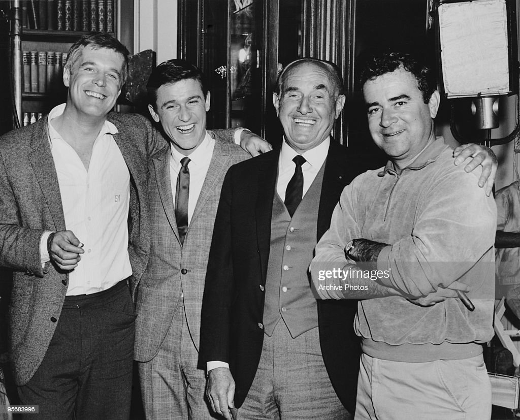 actors George Peppard (1928 - 1994) and Roddy McDowall (1928 - 1998), producer Jack Warner (1892 - 1978) and director Jack Smight (1925 - 2003), possibly on the set of Smight's film 'The Third Day', 1965.
