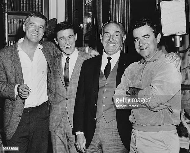 Actors George Peppard and Roddy McDowall , producer Jack Warner and director Jack Smight , possibly on the set of Smight's film 'The Third Day', 1965.