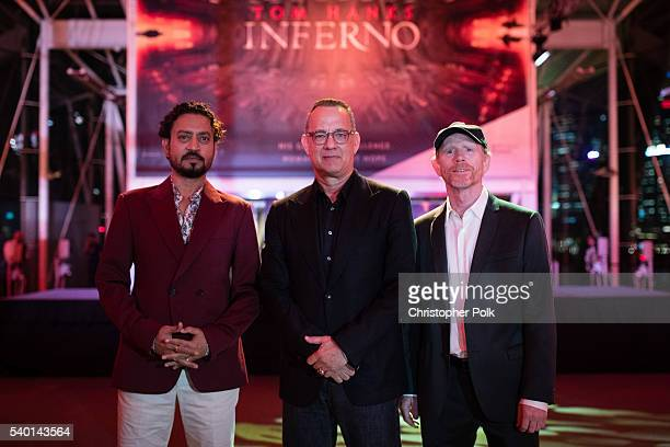 Actors Irrfan Khan and Tom Hanks with director Ron Howard at the Inferno red carpet and photo call at the ArtScience Museum at Marina Bay Sands on...