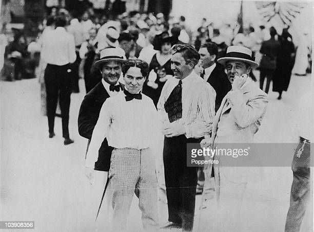 actors Thomas H Ince and Charlie Chaplin with directors Mack Sennett and DW Griffith at the Keystone studios Edendale California 1915