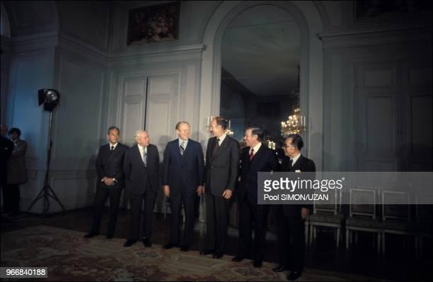 Aldo Moro , Harold Wilson , Gerald Ford , Valery Giscard d'Estaing , Helmut Schmidt and Takeo Miki .