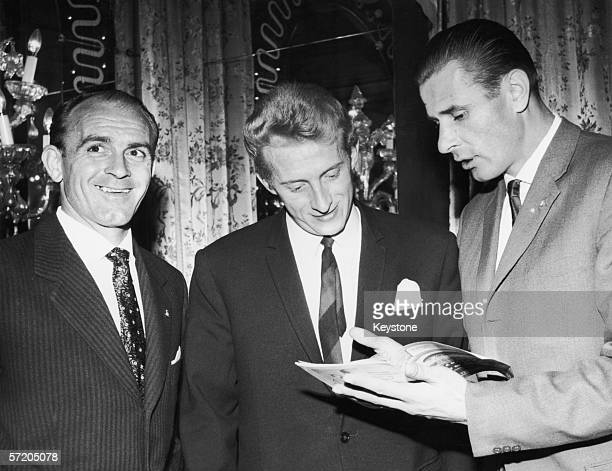 Alfred Di Stefano of Spain Denis Law of England and Lev Yashin of Russia at a dinner at the Cafe Royal London 23rd October 1963 They have just played...