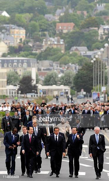 Left to right Alpha Conde Guinea's president Dmitry Medvedev Russia's president Naoto Kan Japan's prime minister John Lipsky acting managing director...