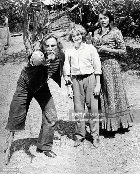 American actor Kirk Douglas, as Peg, and English actors Mark Lester, as Jamie, and Lesley-Anne Down as Lucy-Ann, in 'Scalawag', directed by Douglas,...