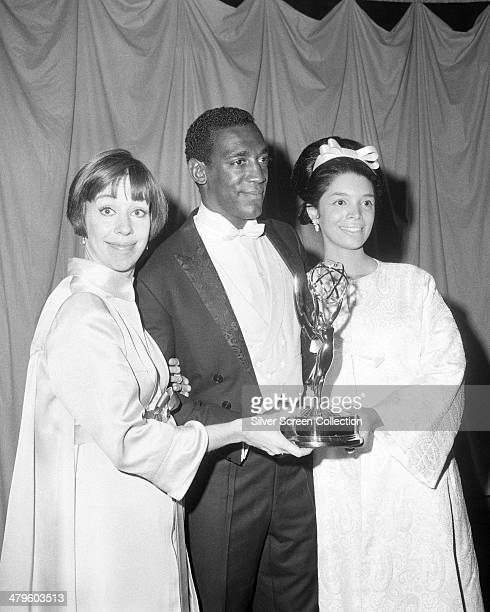 American actorcomedians Carol Burnett and Bill Cosby with Cosby's wife Camille at the 18th Emmy Awards ceremony at the Hollywood Palladium Los...