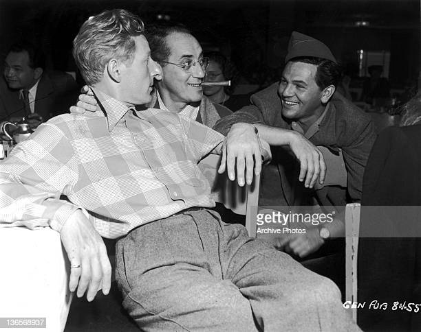American actors Danny Kaye Groucho Marx and John Garfield in the commissary at Warner Bros Studios Burbank California USA 1945 In the background is...