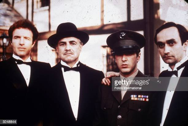 Left to right American actors James Caan Marlon Brando Al Pacino and John Cazale pose together outdoors in a still from director Francis Ford...