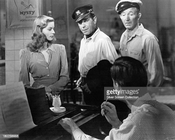American actors Lauren Bacall as Marie 'Slim' Browning Humphrey Bogart as Harry 'Steve' Morgan and Walter Brennan as Eddie with American musician...