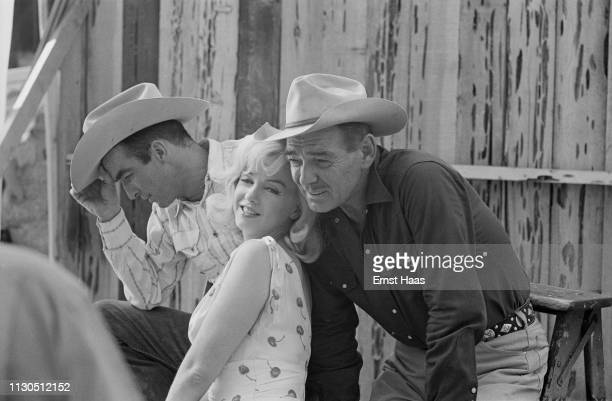 American actors Montgomery Clift Marilyn Monroe and Clark Gable during the location shoot for John Huston's 'The Misfits' in the Nevada Desert 1960
