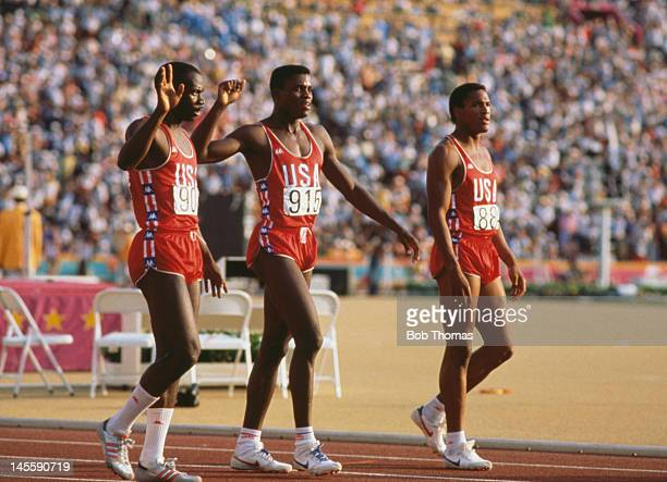 US athletes Thomas Jefferson Carl Lewis and Kirk Baptiste at the final of the Men's 200 Metres at Los Angeles Memorial Coliseum during the Olympic...