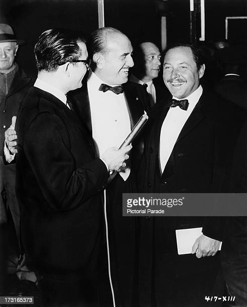 American filmmaker Jerry Warren , Warner Bros President Jack Warner and American playwright Tennessee Williams at the premiere of 'Baby Doll' at the...