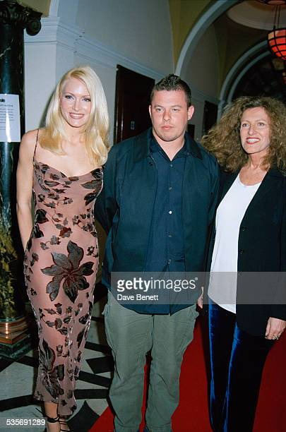 American model Caprice Bourret with fashion designers Alexander McQueen and Nicole Farhi at the Smirnoff International Fashion Awards held at Chelsea...