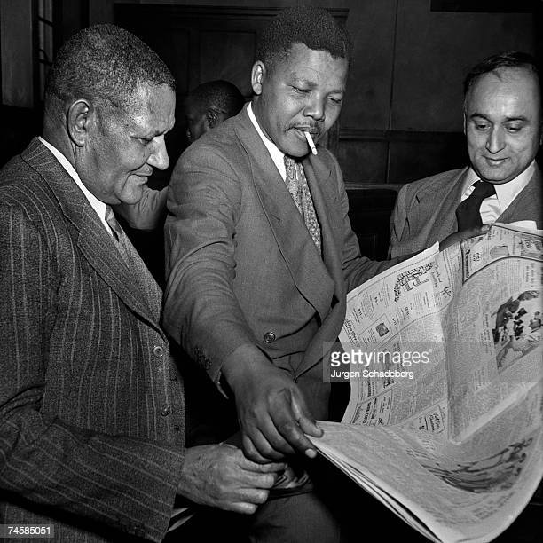 Left to right ANC leader JS Moroka leader of the ANC Youth League Nelson Mandela and President of the South African Indian Congress Yusuf Dadoo...