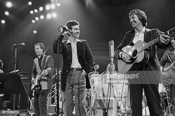 Andy Fairweather Low Ronnie Lane Eric Clapton and Bill Wyman performing on stage at a charity concert for ARMS held at the Royal Albert Hall London...