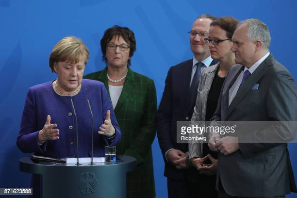 Left to right Angela Merkel Germany's chancellor gestures while speaking as Brigitte Zypries Germany's economy and energy minister Peter Bolfinger...