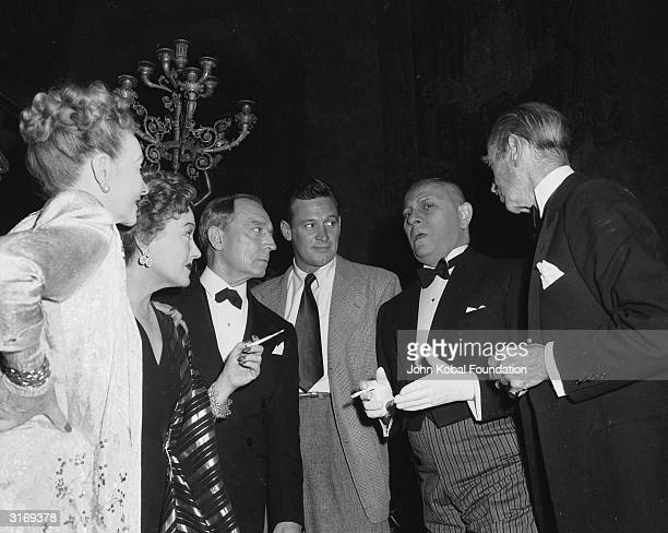 Left to right : Anna Q Nilsson, , Gloria Swanson , Buster Keaton , William Holden , Erich von Stroheim and HB Warner on the set of the Hollywood...