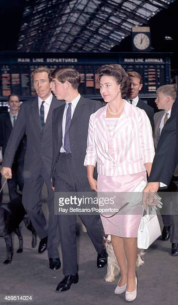 Left to right Antony ArmstrongJones Prince Charles and Princess Margaret with a dog on a lead at Liverpool Street Station in London on 5th August...