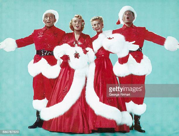 Left to right are; Actor Bing Crosby, Actresses Rosemary Clooney and Vera Ellen, and Actor Danny Kaye, dressed in Christmas colors as they sing...