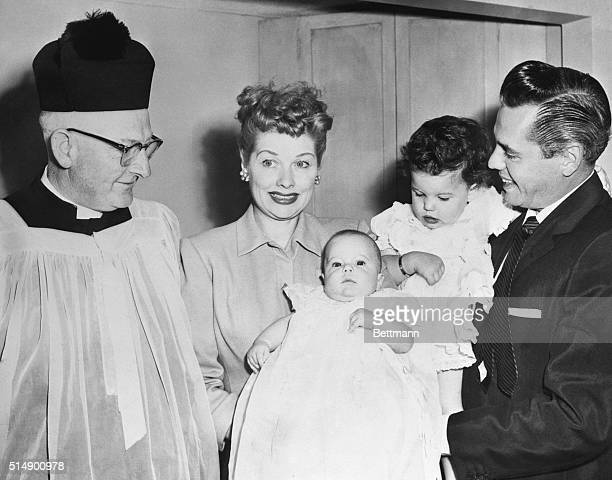 Left to right are Father Michael Hurley Lucille Ball Desiderio Alberto Arnaz IV baby who was christened Lucie Desiree Arnaz and Desi Arnaz