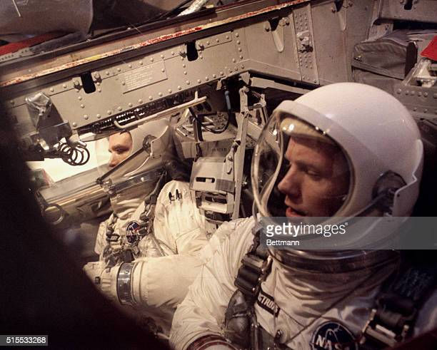 Left to right are Gemini 8 Astronauts David Scott and Neil Armstrong during simulated tests prior to the Gemini 8 space flight