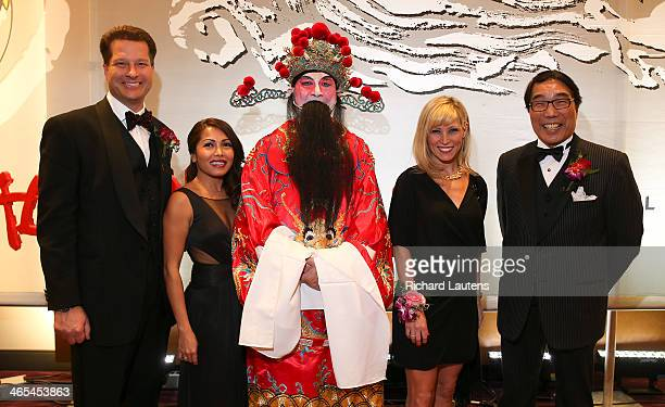 Left to right are Randy and Eva VanDerStarren with the God of Fortune Lesly Tayles and Stephen Siu president of the Yee Hong Community Wellness...