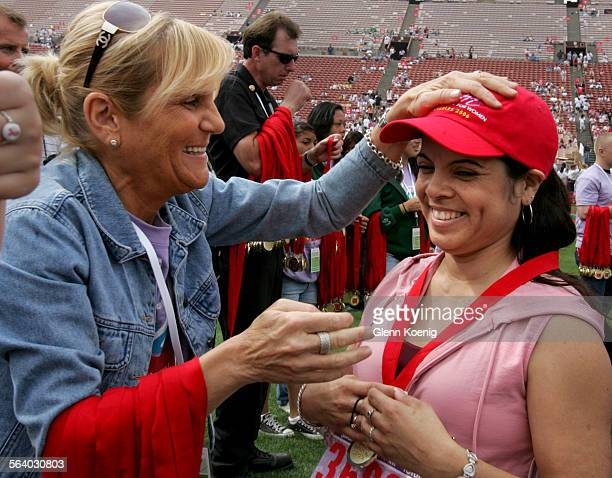 left to right Audrey Giero gives a pat on the head to cancer survivor Valerie Martinez just after Martinez completed the 5k walk during the...