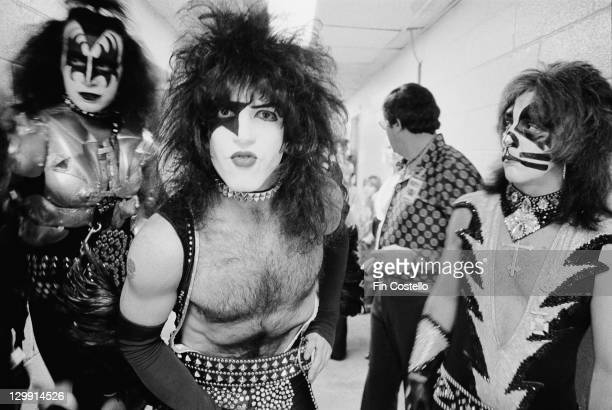 bassist Gene Simmons guitarist Paul Stanley and drummer Peter Criss of American heavy metal group Kiss backstage circa 1975