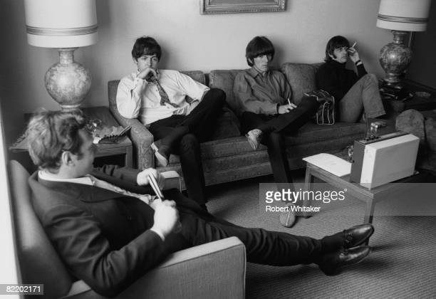Beatles manager Brian Epstein Paul McCartney George Harrison and Ringo Starr at the Westwood Hotel in Anchorage Alaska 27th28th June 1966 En route...