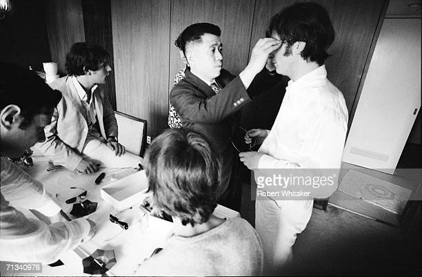 Beatles' manager Brian Epstein, road manager Neil Aspinall, Ringo Starr , a local optician, John Lennon and George Harrison selecting some new...